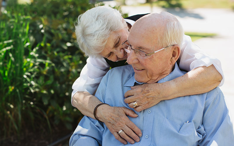 Elderly caucasian couple hugging