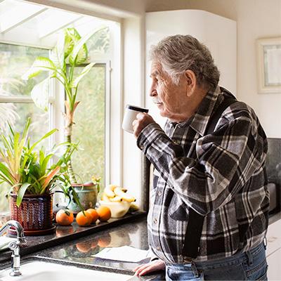 Latino man with chronic disease drinking coffee